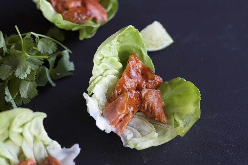 Spicy-sweet salmon wrapped in crisp lettuce cups and topped with ...